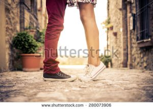 stock-photo-couple-kissing-outdoors-lovers-on-a-romantic-date-at-sunset-girls-stands-on-tiptoe-to-kiss-her-280073906